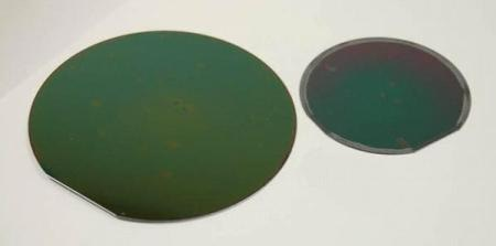 Whole silicon wafers, coated with Low-κ materials.