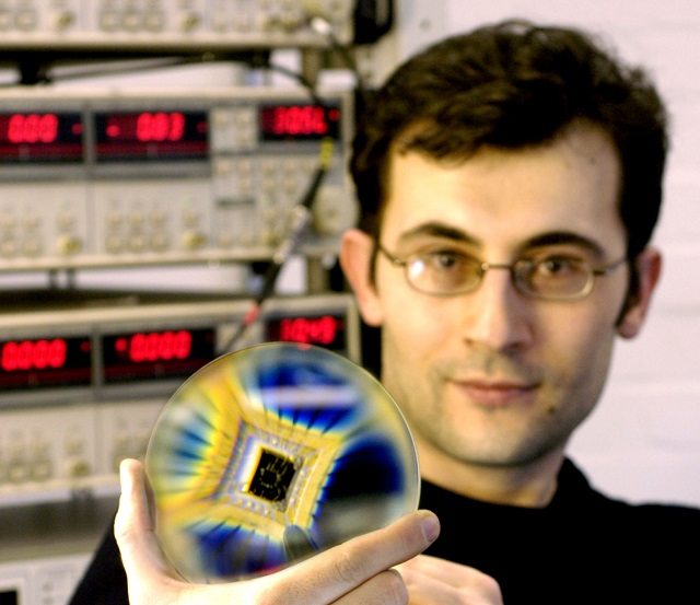 Dr Ponomarenko who carried out this work shows his research sample: graphene quantum dots on a chip.