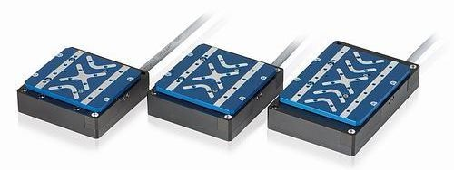 Compact linear stage series with flat-design voice coil motors: models V-522, V-524, and V-528 (from left to right)