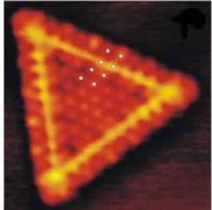 AZoNano, Nanotechnology - This graphic shows a triangular single layer MoS2 nanocluster. In figures 2 and 3, the small white dots illustrate the position of the protrusions.
