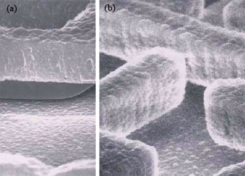 AZoNano - The A to Z of Nanotechnology - SEM micrographs showing the original polysilicon surface texture (a) of the microshutter sidewall and the Tefl on-like coated microstructure (b) which can signifi cantly reduce stiction in this type of microsystem.